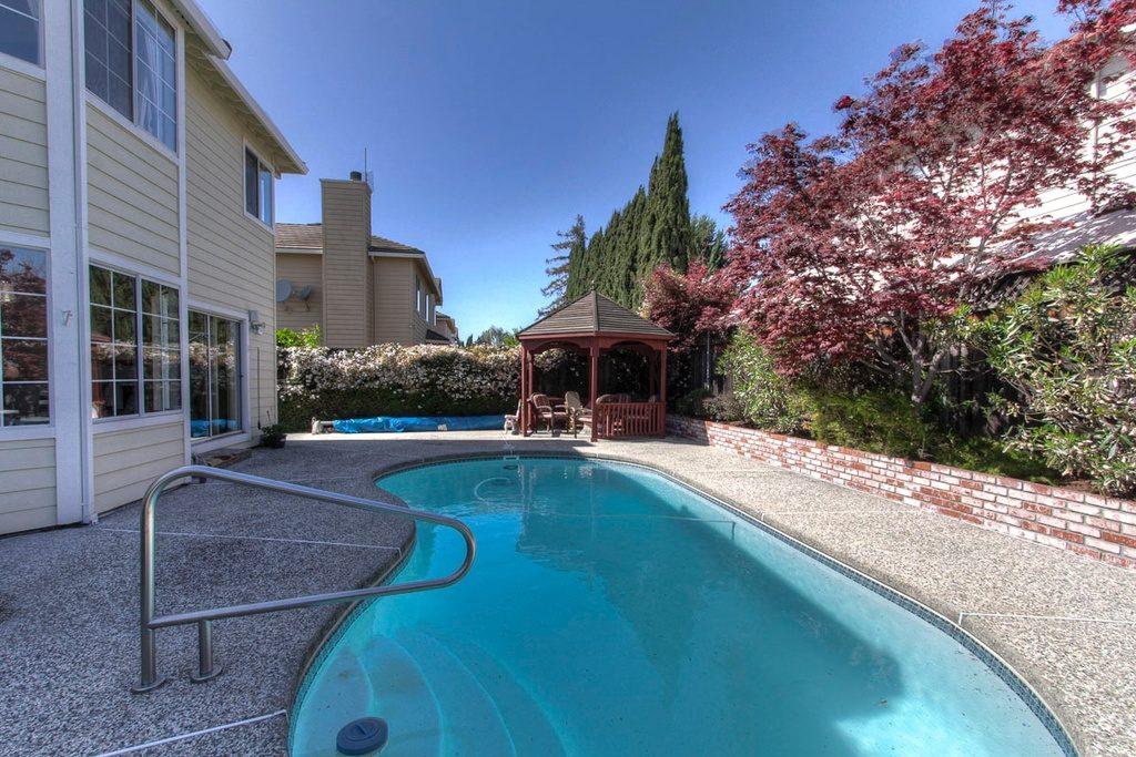 Backyard with pool, spa, gazebo and fire pit